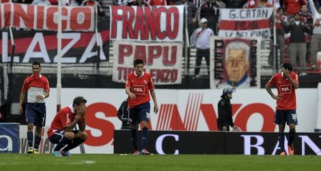 Fans watch dejected Independiente players after River Plate beat them 2-1 in the Monumental stadium on June 9, 2013