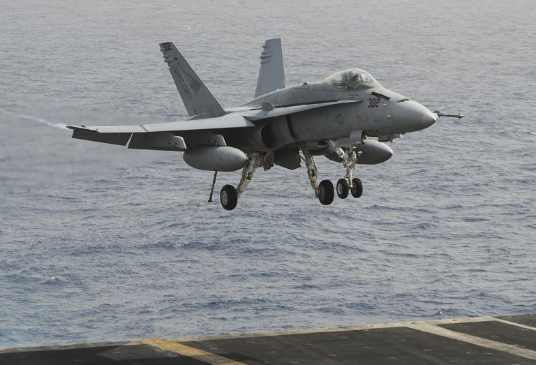 United States  fighter jet avoids collision with Iranian drone
