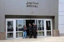 Hamas security officers stand guard at the door of the arrival hall at the Rafah border crossing in the Gaza Strip, Tuesday, Oct. 31, 2017.