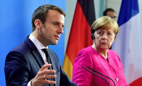 German Chancellor Angela Merkel and French President Emmanuel Macron say they are ready to change EU treaties if necessary