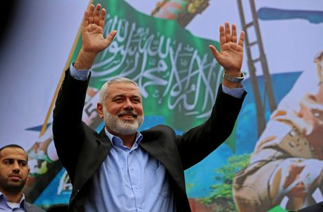 File - In this Friday, Dec. 12, 2014 file photo, Palestinian top Hamas leader Ismail Haniyeh greets supporters during a rally to commemorate the 27th anniversary of the Hamas militant group, at the main road in Jebaliya in the northern Gaza Strip.