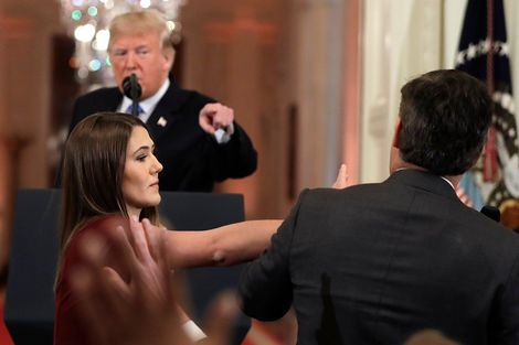 As President Donald Trump points to CNN's Jim Acosta, a White House aide takes the microphone from him during a news conference in the East Room of the White House, Wednesday, Nov. 7, 2018, in Washington.
