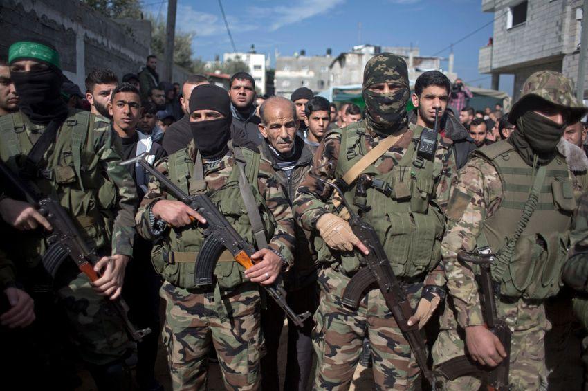 Masked Palestinian Hamas gunmen take part in the funeral of Hamas militant, Jan. 23, 2019