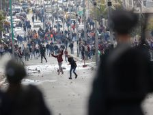 Palestinians clash with Israeli troops during a protest against U.S. President Donald Trump's decision to recognize Jerusalem as the capital of Israel in the West Bank city of Bethlehem, Thursday, Dec. 7, 2017.