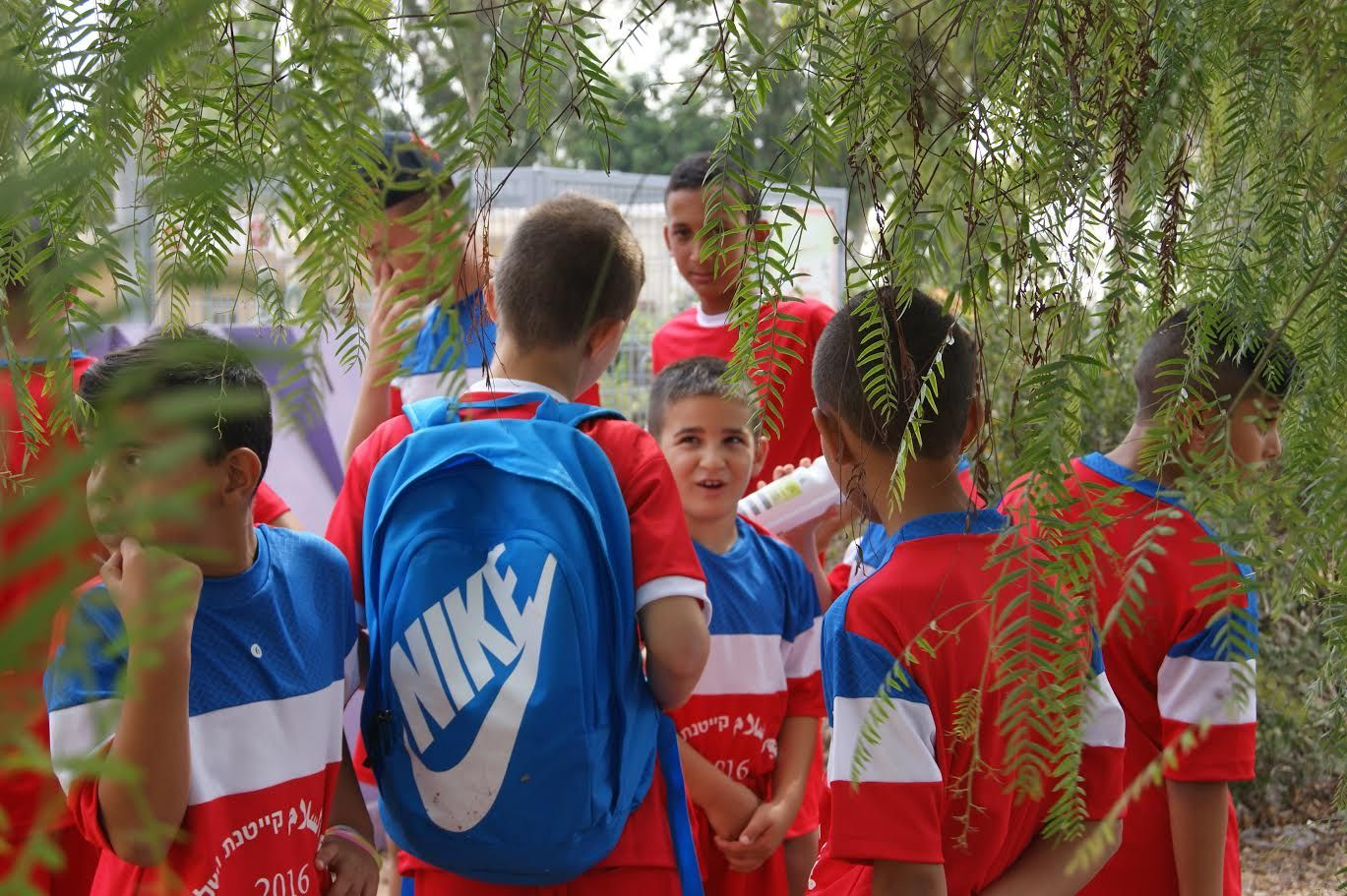 Boys get ready for their first game at the Soccer for Peace summer camp