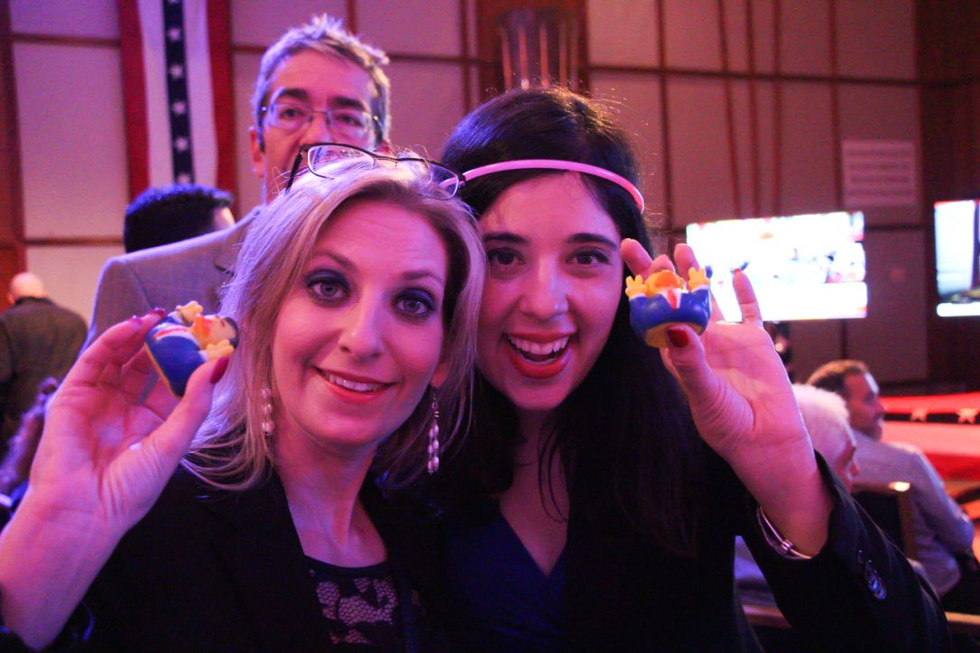 Two women show off the president ducks they won at the US embassy election party in Tel Aviv on November 8, 2016