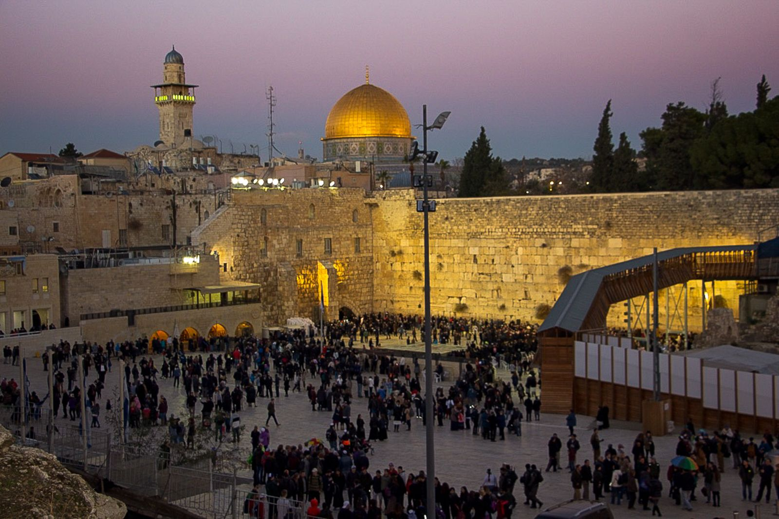 People arrive at the Western Wall for the menorah lighting ceremony on December26, 2016