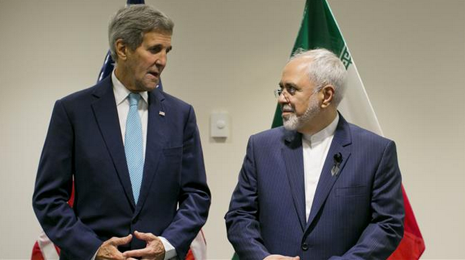 US Secretary of State John Kerry (L) poses with Iranian Foreign Minister Javad Zarif during a bilateral talk at the United Nations headquarters in New York on September 26, 2015.