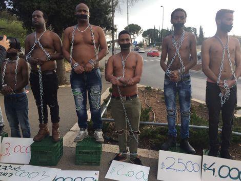 Mock 'slave trade' auction outside Knesset, Jan 2018
