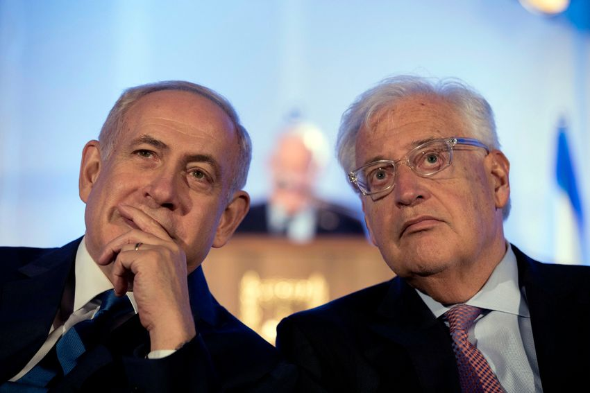 FILE- Israeli Prime Minister Benjamin Netanyahu and David Friedman, the United States Ambassador to Israel attend a ceremony celebrating the 50th anniversary of the unification of Jerusalem on May 21, 2017.