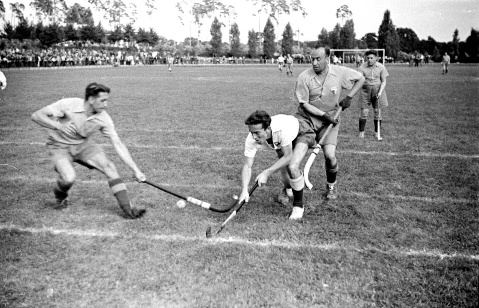 """""""A field hockey game during the international """"Bar-Kochba"""" sports games with the participation of the team """"Hakoach Vienna"""". The games were held in Grunewald, Berlin, Germany 1937"""""""