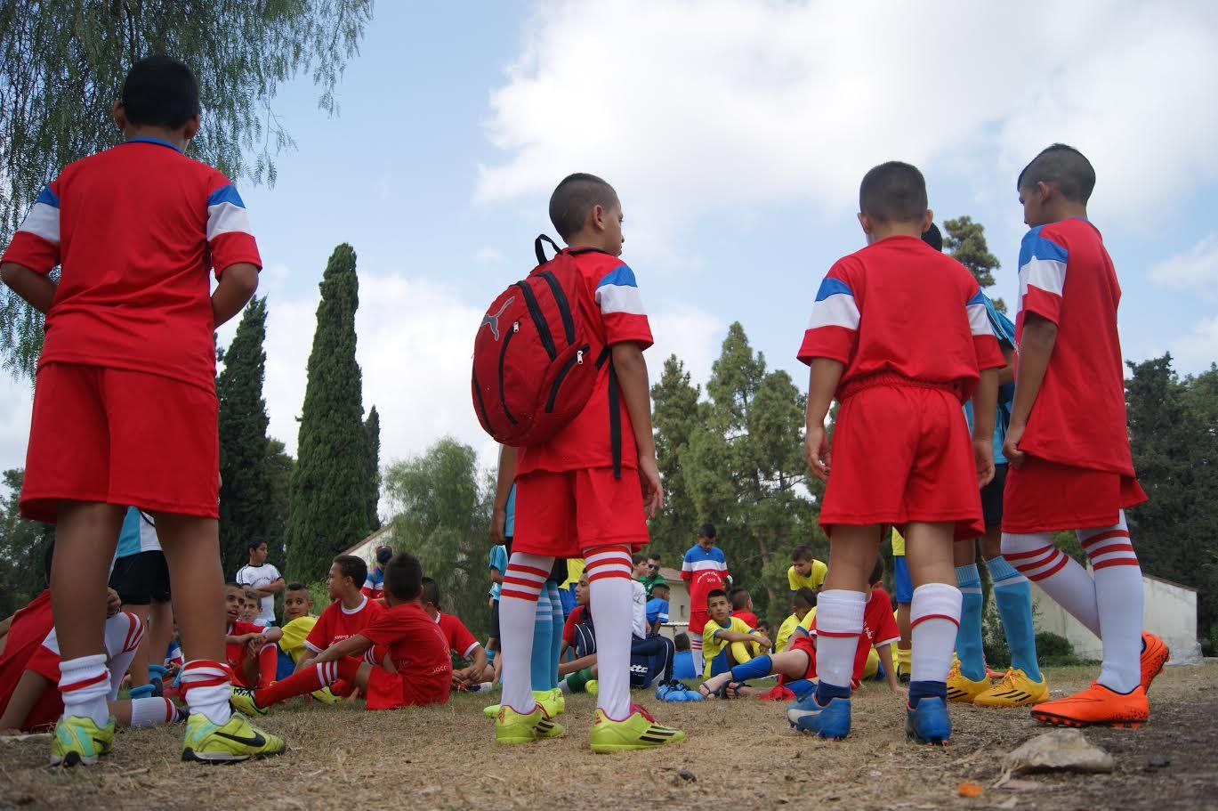 Young Arab and Jewish boys participating in the Soccer for Peace summer camp 2016 prepare for their first training session
