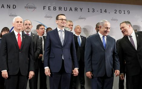FILE - In this Thursday, Feb. 14, 2019 file photo, United States Vice President Mike Pence, Prime Minister of Poland Mateusz Morawiecki, Israeli Prime Minister Benjamin Netanyahu and United State Secretary of State Mike Pompeo, from left, stand on a podiu