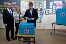 Yair Netanyahu, the son of Israeli Prime Minister Benjamin Netanyahu, left, casts his ballot together with his parents at a polling station in 2013.