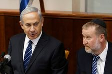 Israel's Prime Minister Benjamin Netanyahu, left, sits next to Cabinet Secretary Avichai Mandelblit during the weekly cabinet meeting in Jerusalem Sunday, May 19, 2013