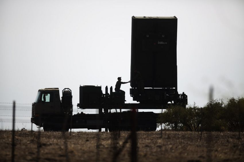 An Israeli soldier sits next to an anti-missile radar positioned in the North of Israel on August 29, 2013.