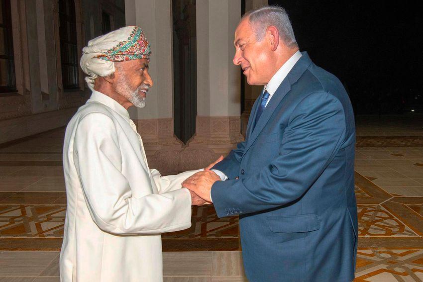 FILE - Oman's Sultan Qaboos, left, greets Israeli Prime Minister Benjamin Netanyahu in Muscat, Oman, on Oct. 26, 2018.