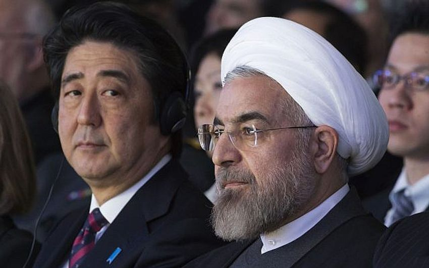 In this Jan. 22, 2014 file photo, Japanese Prime Minister Shinzo Abe, left, and Iranian President Hassan Rouhani, attend a session of the World Economic Forum in Davos, Switzerland
