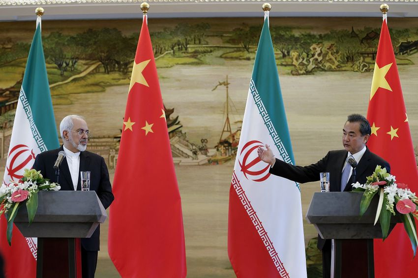 Chinese FM Wang Yi, right, and Iranian FM Mohammad Javad Zarif attend a joint press conference Tuesday, Sept. 15, 2015 in Beijing, China