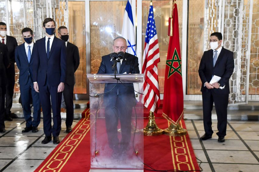 Moroccan FM Nasser Bourita (R) and US Senior Advisor Jared Kushner (C-L) listen to Israeli National Security Advisor Meir Ben Shabbat (C) speak at the Royal Palace in the Moroccan capital Rabat, on December 22, 2020.