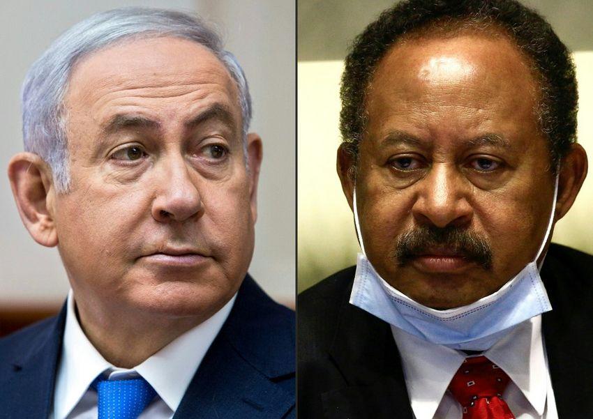 Israeli Prime Minister Benjamin Netanyahu (L) d and Sudan's Prime Minister Abdullah Hamduk on July 26, 2020.