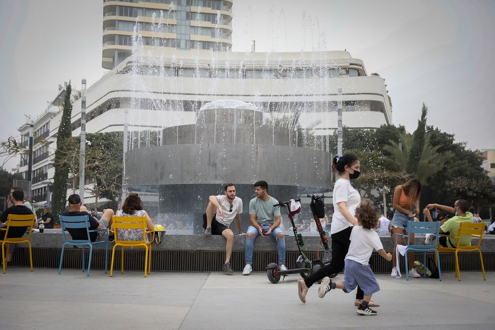 Israelis enjoy a day off work in Tel Aviv, during elections day, March 23, 2021.