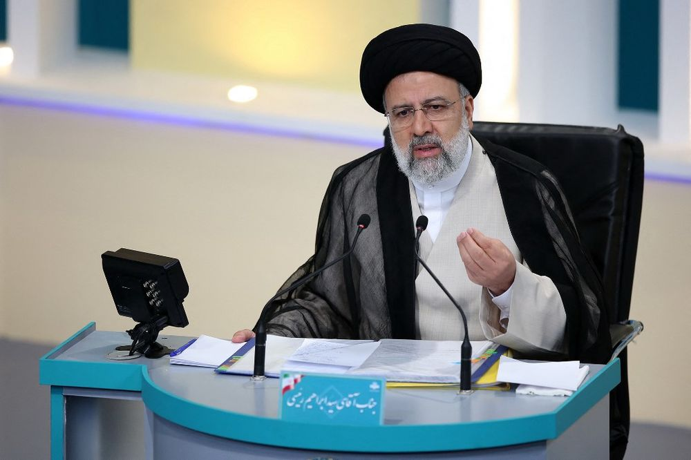 Iranian presidential candidate Ebrahim Raisi during the second televised debate ahead of the June 18 election, at the Iran State television studio, Tehran, June 8, 2021.