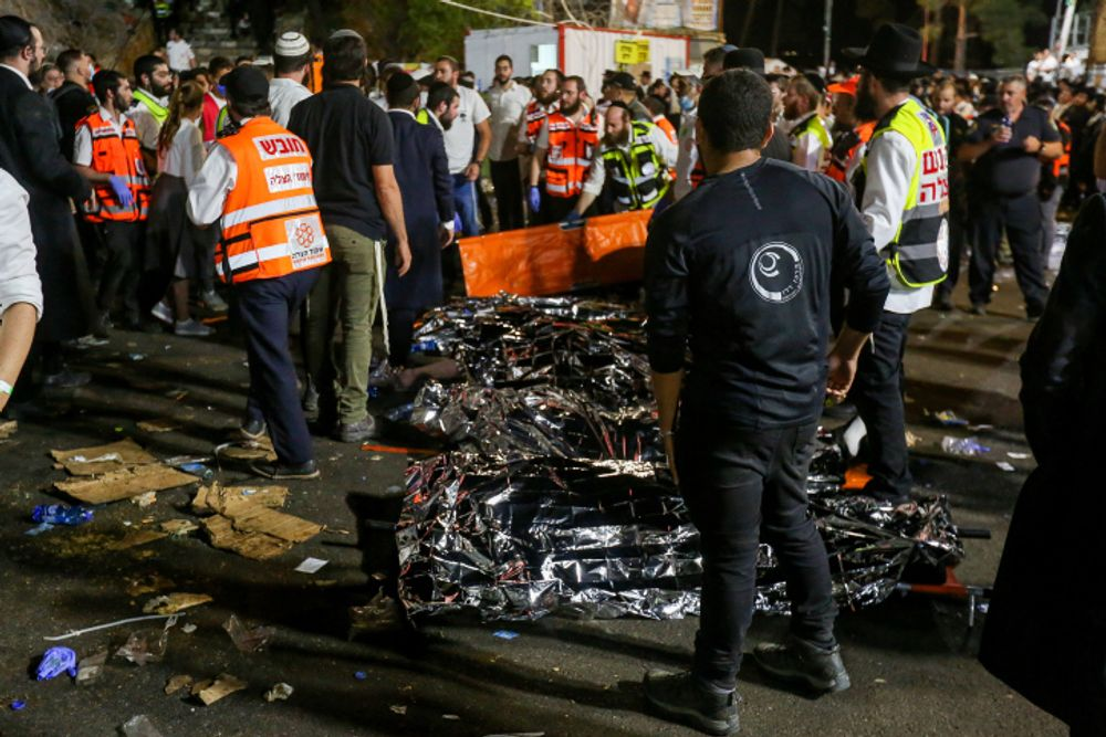 Israeli rescue forces and police at the scene after a mass fatality scene during the celebrations of the Jewish holiday of Lag Baomer on Mt. Meron, in northern Israel on April 30, 2021.