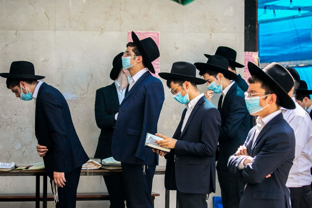 ILLUSTRATION - Ultra-Orthodox Jews walk in the Haredi town of Bnei Brak on October 14, 2020, during a nationwide lockdown against the spread of COVID-19.