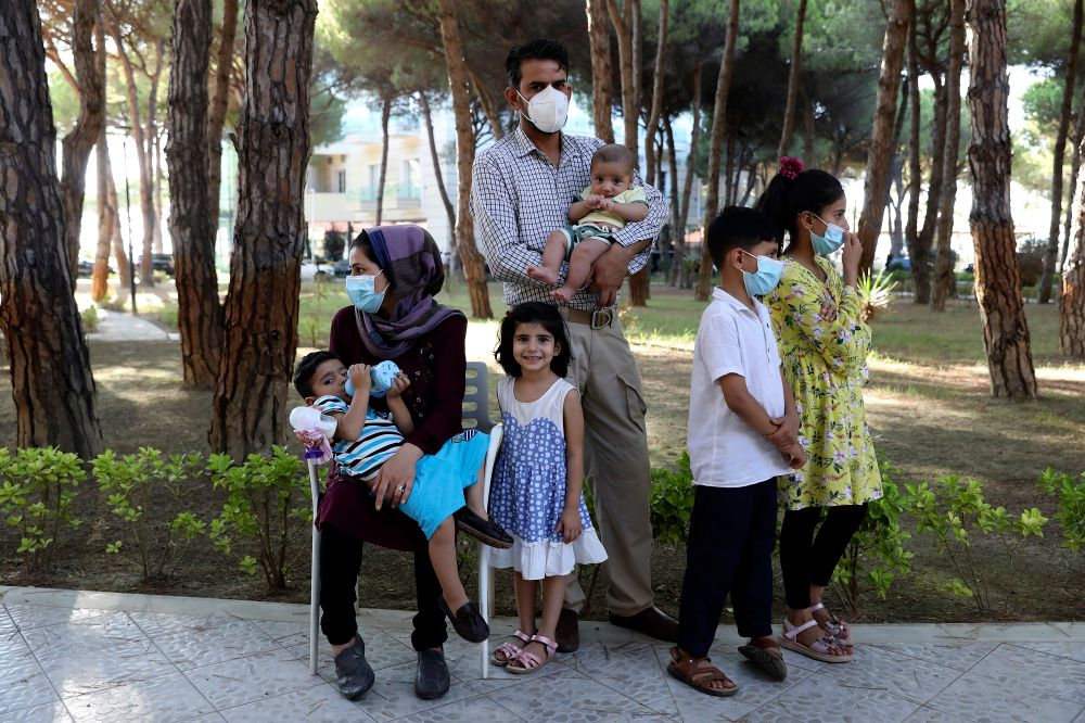 An Afghan family gather at a resort which is accommodating Afghan refugees in Golem, 45 kilometers (30 miles) west of the capital Tirana, August 27, 2021.