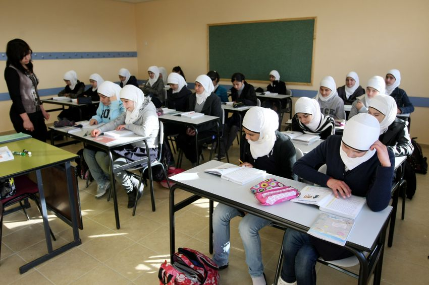 Young Arab girls seen studying during a lesson in the newly opened elementary school in the Arab neighborhood of Umm Tuba, in East Jerusalem. December 13, 2011.
