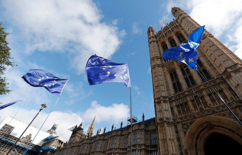 The EU flag flaps in the wind in front of the Houses of Parliament in London, Wednesday, Sept. 25, 2019.