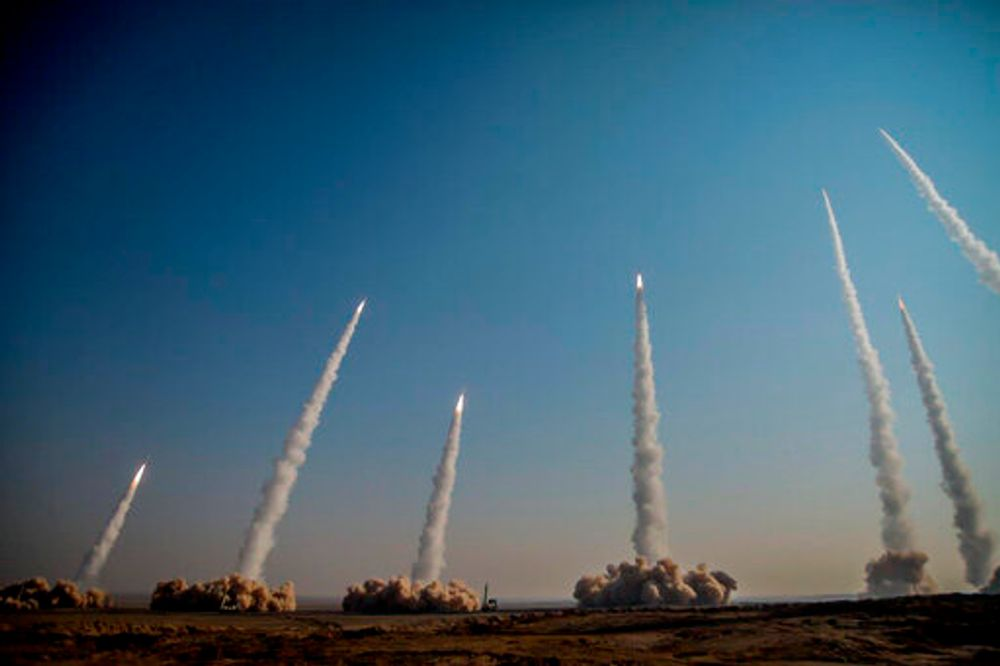 The Iranian Revolutionary Guard launches several missiles during a drill in a desert in the country's center on January 15, 2021.