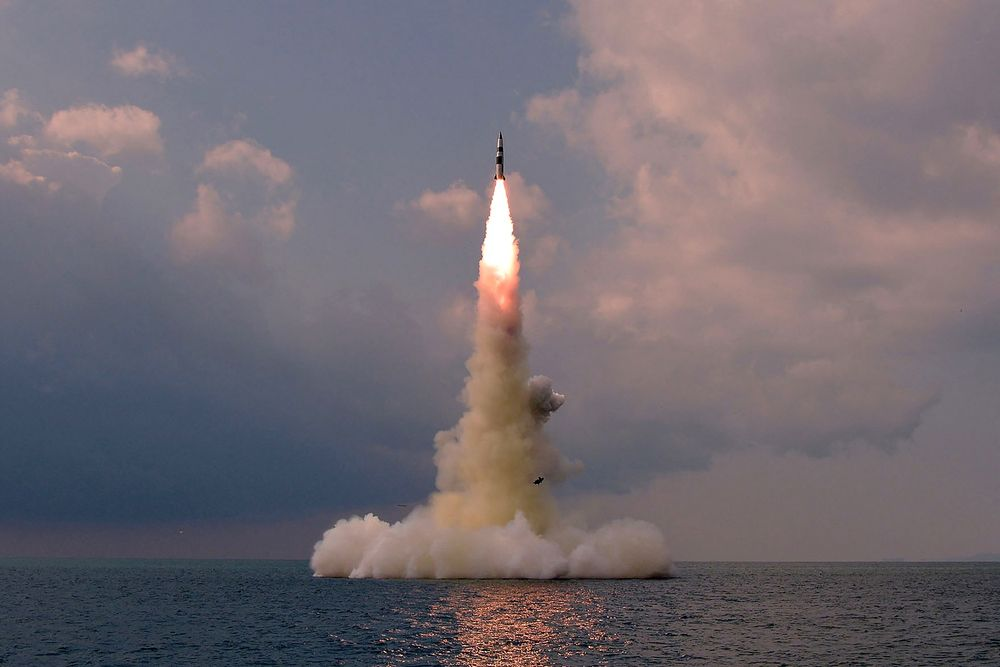 A picture taken on October 19, 2021 shows test fire of a new type submarine-launched ballistic missile in an undisclosed location in North Korea.