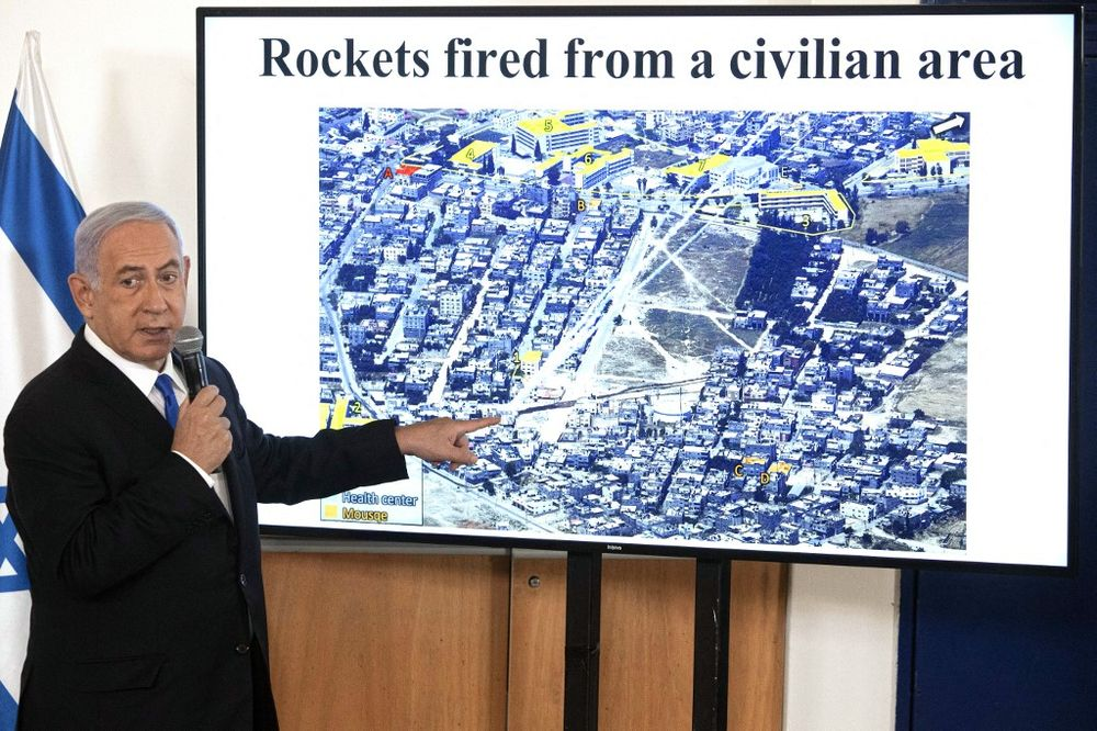 Israel's Prime Minister Benjamin Netanyahu gestures as he shows a slideshow during a briefing to ambassadors to Israel at the Hakirya military base in Tel Aviv, on May 19, 2021.