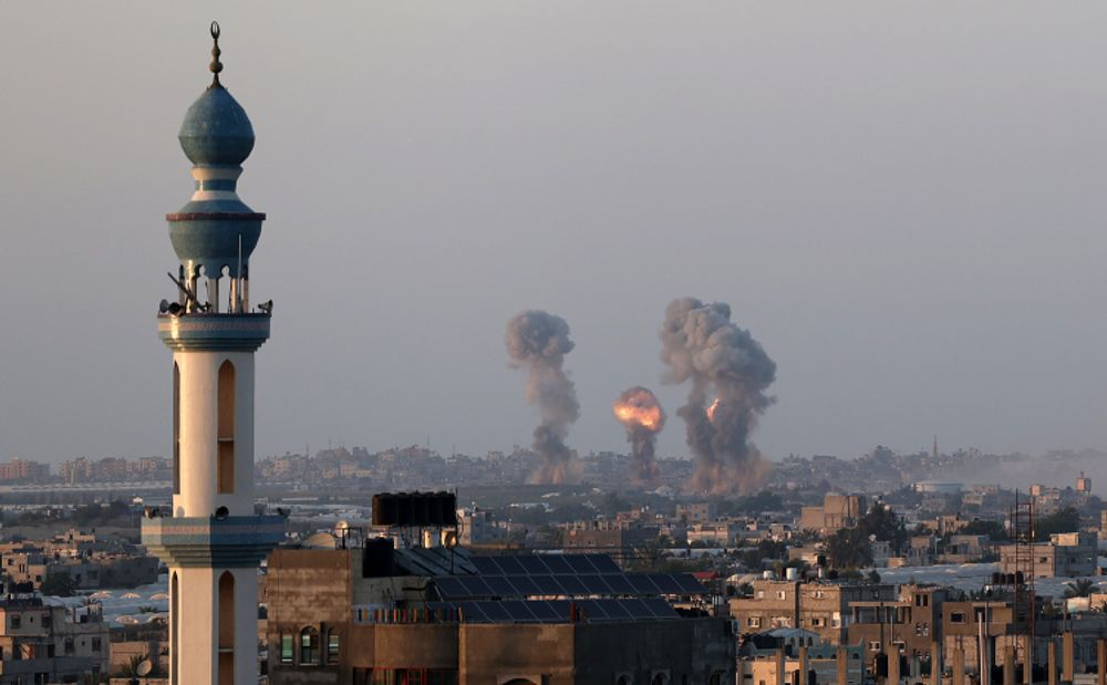 Smoke and flames rise after an Israeli airstrike iin the southern Gaza Strip, amid the most intense Israeli-Palestinian hostilities in seven years. May 12, 2021.