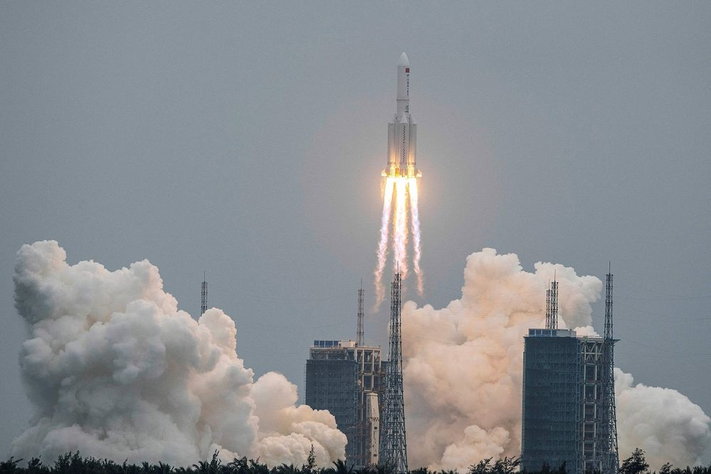 The Long March 5B rocket, carrying the core module of China's Tianhe space station, takes off from the Wenchang Space Launch Center in southern China's Hainan Province, April 29, 2021